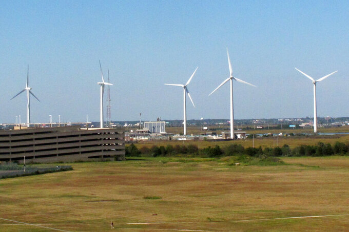 This Oct. 1, 2020 photo shows wind turbines at the Atlantic County Utilities Authority plant in Atlantic City, N.J. On Tuesday, June 15, 2021, New Jersey lawmakers advanced a proposed law that would fast track offshore wind energy projects by pre-empting local controls over power lines and other onshore infrastructure associated with them. (AP Photo/Wayne Parry)