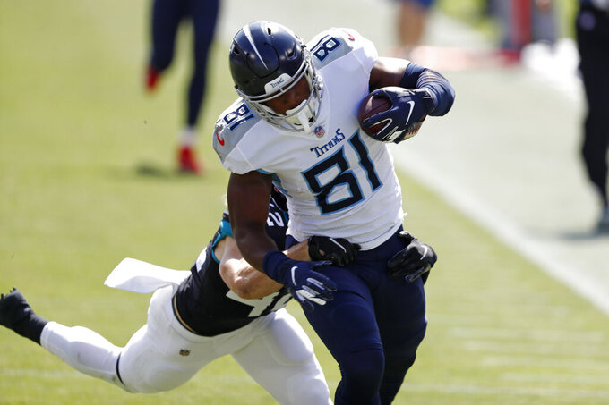 Tennessee Titans tight end Jonnu Smith (81) catches a pass ahead of Jacksonville Jaguars safety Andrew Wingard (42) for a 63-yard gain in the first half of an NFL football game Sunday, Sept. 20, 2020, in Nashville, Tenn. (AP Photo/Wade Payne)