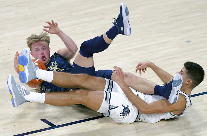 Montana State guard Harald Frey, left, and Utah State guard Diogo Brito scramble for the ball during an NCAA college basketball game Tuesday, Nov. 5, 2019, in Logan, Utah. (Eli Lucero/The Herald Journal via AP)