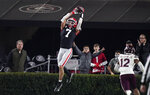 Georgia wide receiver Jermaine Burton makes a touchdown reception against Mississippi State during the first half of an NCAA college football game Saturday, Nov. 21, 2020, in Athens, Ga. (AP Photo/Brynn Anderson)