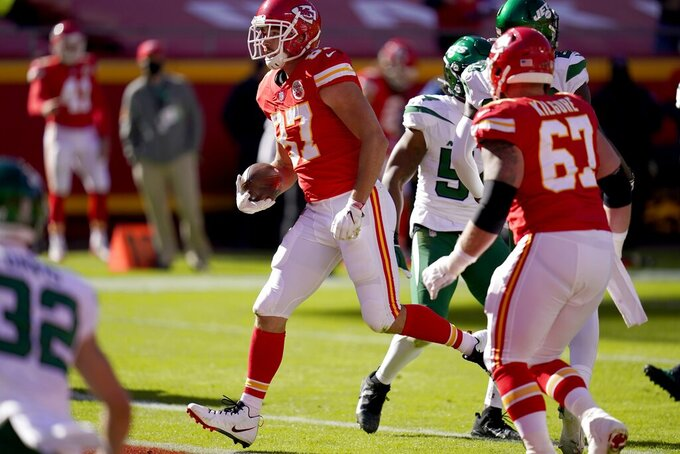 Kansas City Chiefs tight end Travis Kelce (87) reaches the end zone for a touchdown after catching a pass in the first half of an NFL football game against the New York Jets on Sunday, Nov. 1, 2020, in Kansas City, Mo. (AP Photo/Jeff Roberson)