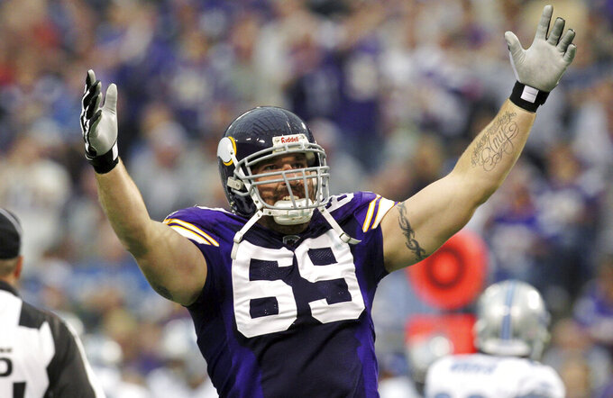FILE - In this Sept. 25, 2011 file photo, Minnesota Vikings defensive end Jared Allen gestures during the first half an NFL football game against the Detroit Lions, in Minneapolis. Peyton Manning, Charles Woodson, Jared Allen and Calvin Johnson are first-year eligible players to make the list of 25 semifinalists for the Pro Football Hall of Fame's class of 2021. (AP Photo/Genevieve Ross, File)