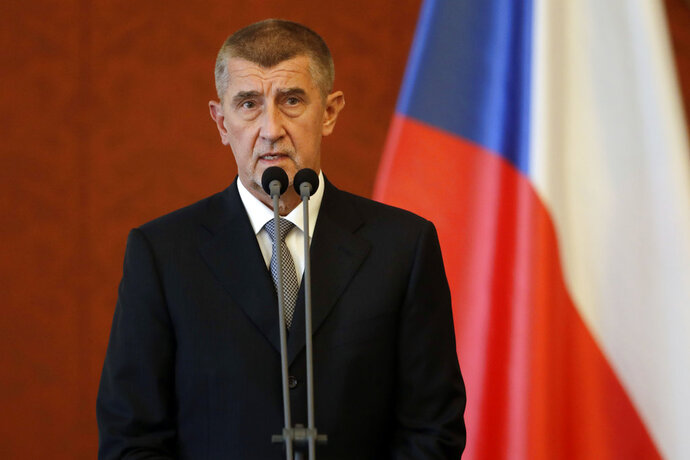 FILE- In this June 6, 2018 file photo newly appointed Prime Minister Andrej Babis addresses the media at the Prague Castle in Prague, Czech Republic. Babis has signed a deal the far-left Communist Party in a move that will give the maverick Communists a role in governing for the first time since the country's 1989 anti-communist Velvet Revolution. (AP Photo/Petr David Josek, file)
