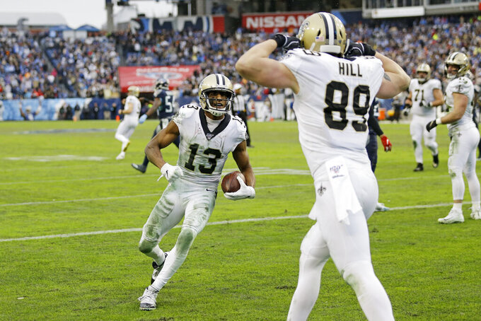 New Orleans Saints wide receiver Michael Thomas (13) celebrates with tight end Josh Hill (89) after Thomas scored a touchdown on a 2-yard pass reception against the Tennessee Titans in the second half of an NFL football game Sunday, Dec. 22, 2019, in Nashville, Tenn. The Saints won 38-28. (AP Photo/James Kenney)