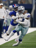 New York Giants cornerback Janoris Jenkins (20) wraps up Dallas Cowboys running back Ezekiel Elliott (21) after a long run in the first half of a NFL football game in Arlington, Texas, Sunday, Sept. 8, 2019. (AP Photo/Ron Jenkins)