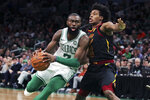 Boston Celtics guard Jaylen Brown (7) drives to the basket against Cleveland Cavaliers guard Collin Sexton, right, during the second half of an NBA basketball game in Boston, Monday, Dec. 9, 2019. The Celtics won 110-88. (AP Photo/Charles Krupa)