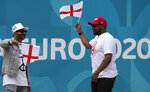 English football fans cheer outside of Wembley stadium in London, Friday, July 9, 2021. The Euro 2020 soccer championship final match between Italy and England will be played at Wembley stadium on Sunday. (AP Photo/Frank Augstein)