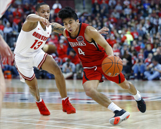 Southeast Missouri State's Oscar Kao, right, drives to the basket against Ohio State's C.J. Walker during the first half of an NCAA college basketball game Tuesday, Dec. 17, 2019, in Columbus, Ohio. (AP Photo/Jay LaPrete)