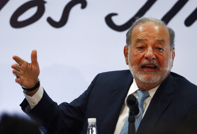 Mexican billionaire Carlos Slim gives a press conference in Mexico City, Monday, April 16, 2018. Slim says he would be concerned if leftist presidential candidate Andres Manuel Lopez Obrador wins on July 1 and cancels the new Mexico City airport project. (AP Photo/Eduardo Verdugo)
