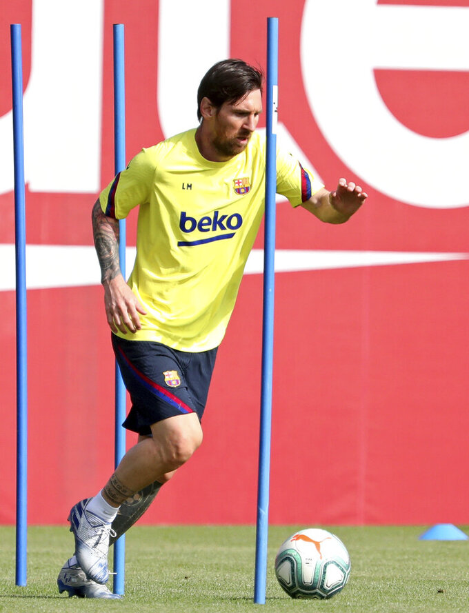 In this photo provided by FC Barcelona, Barcelona's Lionel Messi trains in Barcelona, Spain, on Friday May 8, 2020. Soccer players in Spain returned to train for the first time since the country entered a lockdown nearly two months ago because of the coronavirus pandemic. (Miguel Ruiz/FC Barcelona via AP)