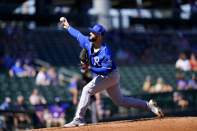 Kansas City Royals starting pitcher Jakob Junis throws against the Chicago Cubs during the first inning of a spring baseball game in Mesa, Ariz., Tuesday, March 2, 2021. (AP Photo/Jae C. Hong)