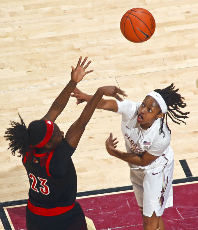 Louisville guard Jazmine Jones (23) shoots over Florida State guard Nicole Ekhomu (12) during the first half of an NCAA college basketball game in Tallahassee, Fla., Thursday, Jan. 24, 2019. (AP Photo/Phil Sears)