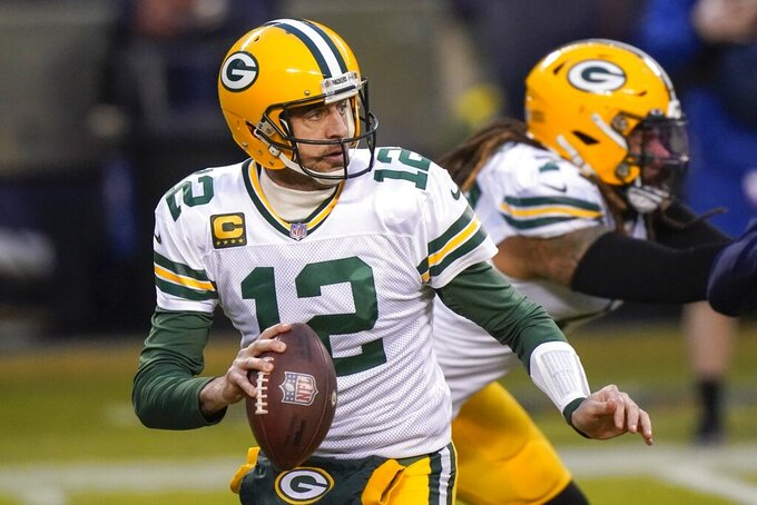Green Bay Packers' Aaron Rodgers drops back to pass during the first half of an NFL football game against the Chicago Bears Sunday, Jan. 3, 2021, in Chicago. (AP Photo/Nam Y. Huh)