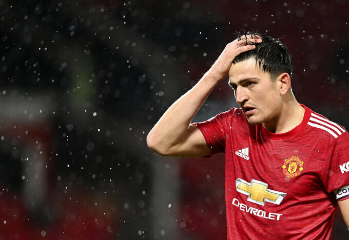 Manchester United's Harry Maguire reacts during the English Premier League soccer match between Manchester United and Chelsea, at the Old Trafford stadium in Manchester, England, Saturday, Oct. 24, 2020. (Michael Regan/Pool via AP)