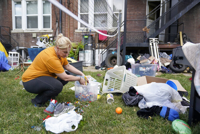 Kristen Bigogno gathers up some of her belongings while being evicted from her home Friday, Sept. 17, 2021, in St. Louis. Bigogno is among thousands of Americans facing eviction now that the national moratorium has ended. (AP Photo/Jeff Roberson)