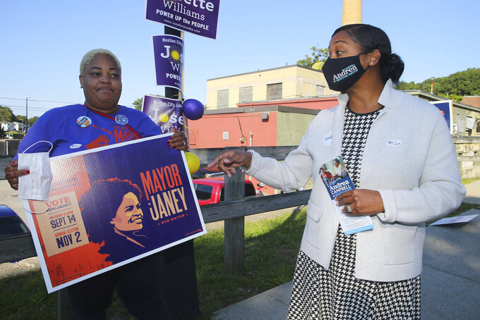Boston mayoral candidate Andrea Campbell, right, talks with Aisha Miller, a supporter of Mayor Kim Janey, outside the Groveland Community Room in Boston, Tuesday, Sept. 14, 2021. On Tuesday, voters cast ballots in a preliminary mayoral election that will select two top contenders from a field of five main candidates all of whom are people of color, four of them women. (AP Photo/Stew Milne)