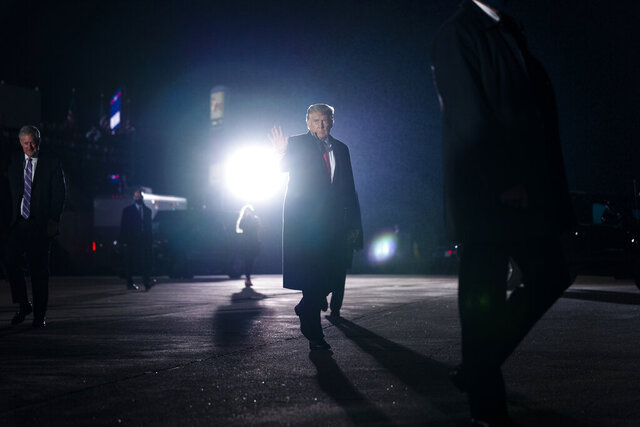 President Donald Trump waves after a campaign rally at Erie International Airport, Tom Ridge Field, Tuesday, Oct. 20, 2020, in Erie, Pa. (AP Photo/Evan Vucci)