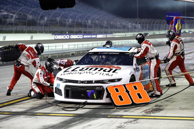 Alex Bowman (88) makes a pit stop during a NASCAR Cup Series auto race Sunday, June 14, 2020, in Homestead, Fla. (AP Photo/Wilfredo Lee)