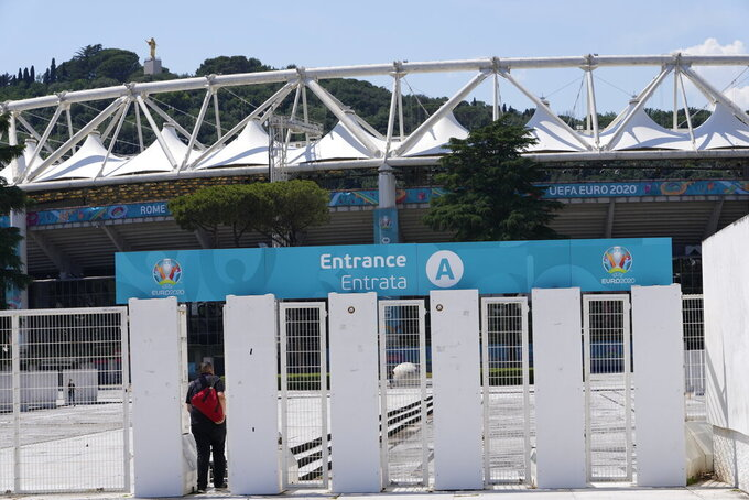 A man enters Rome's Olympic stadium, Wednesday, June 9, 2021. The Euro 2020 gets underway on Friday June 11 and is being played in 11 host cities across 11 countries. (AP Photo/Alessandra Tarantino)