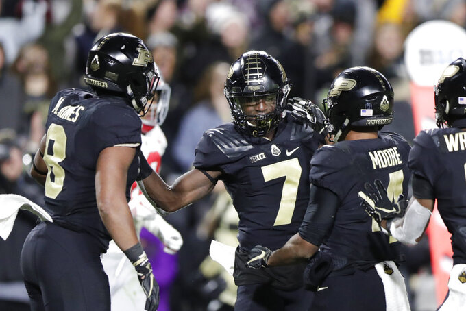Purdue wide receiver Isaac Zico (7) celebrates a touchdown catch with running back Markell Jones (8) and wide receiver Rondale Moore (4) during the first half of an NCAA college football game against Ohio State in West Lafayette, Ind., Saturday, Oct. 20, 2018. (AP Photo/Michael Conroy)