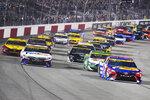 Denny Hamlin (11) and Martin Truex Jr., (19) lead the field st the start of the NASCAR Cup series auto race in Richmond, Va., Saturday, Sept. 11, 2021. (AP Photo/Steve Helber)