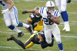 Indianapolis Colts running back Jonathan Taylor (28) tries to break a tackle by Pittsburgh Steelers free safety Minkah Fitzpatrick (39) during the second half of an NFL football game, Sunday, Dec. 27, 2020, in Pittsburgh. (AP Photo/Gene J. Puskar)