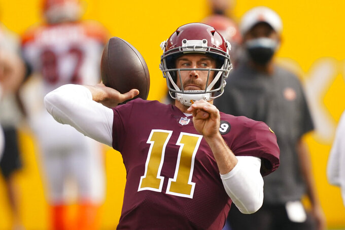Washington Football Team quarterback Alex Smith (11) throws the ball before the start of an NFL football game against the Cincinnati Bengals, Sunday, Nov. 22, 2020, in Landover, Md. (AP Photo/Andrew Harnik)