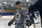 St. Louis Blues' Torey Krug listens to a member of the coaching staff during NHL hockey training camp Tuesday, Jan. 5, 2021, in Maryland Heights, Mo. (AP Photo/Jeff Roberson)