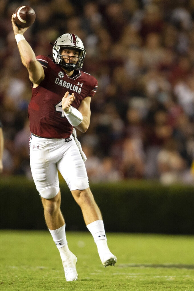 South Carolina quarterback Luke Doty (4) attempts a pass in the second half of an NCAA college football game against Kentucky Saturday, Sept. 25, 2021 at Williams-Brice Stadium in Columbia, S.C. (AP Photo/Hakim Wright Sr.)