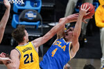 UCLA guard Jaime Jaquez Jr. (4) shoots over Michigan guard Franz Wagner (21) during the first half of an Elite 8 game in the NCAA men's college basketball tournament at Lucas Oil Stadium, Tuesday, March 30, 2021, in Indianapolis. (AP Photo/Michael Conroy)