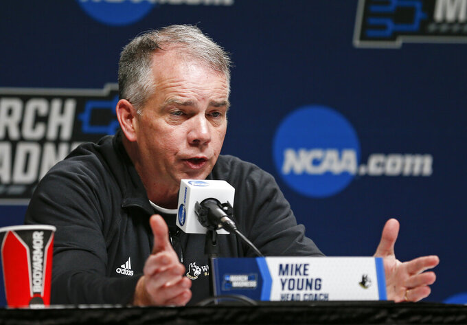 Wofford head coach Mike Young answers questions during a news conference at the NCAA men's college basketball tournament in Jacksonville, Fla., Friday, March 22, 2019. Wofford faces Kentucky in the second round on Saturday.  (AP Photo/Stephen B. Morton)