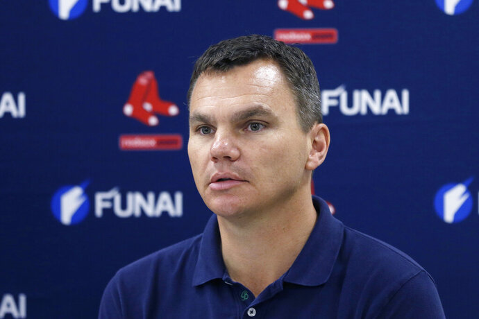 FILE - In this March 24, 2014, file photo, Boston Red Sox general manager Ben Cherington is shown during a press conference in Boston. A person familiar with the decision says the Pittsburgh Pirates have agreed to hire Ben Cherington as their general manager. The person spoke to The Associated Press on condition of anonymity Friday, Nov. 15, 2019, because the agreement has not been announced. (AP Photo/Carlos Osorio, File)