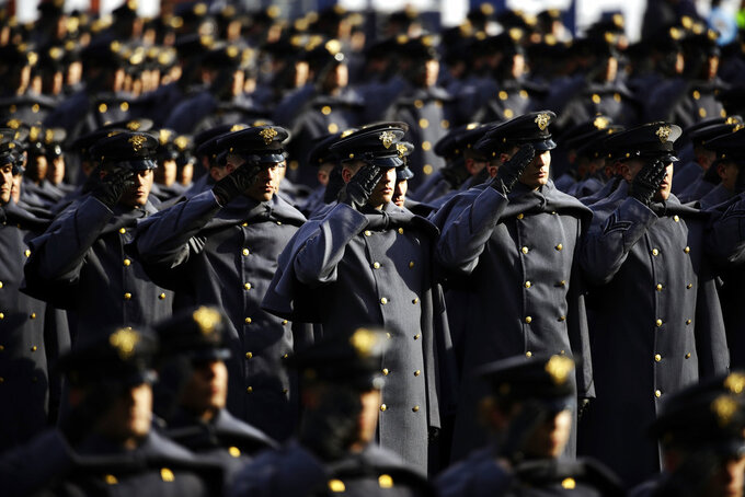 Army Cadets salute ahead of an NCAA college football against Navy, Saturday, Dec. 8, 2018, in Philadelphia. (AP Photo/Matt Rourke)
