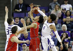 Washington's Matisse Thybulle (4) knocks the ball away from Utah's Sedrick Barefield as Washington's Sam Timmins (33) and Utah's Novak Topalovic watch during the first half of an NCAA college basketball game Wednesday, Feb. 20, 2019, in Seattle. (AP Photo/Elaine Thompson)