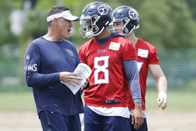 Tennessee Titans quarterbacks coach Pat O'Hara talks with quarterback Marcus Mariota (8) during an organized team activity at the Titans' NFL football training facility Tuesday, June 11, 2019, in Nashville, Tenn. (AP Photo/Mark Humphrey)