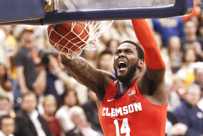 Clemson's Elijah Thomas (14) finishes off a dunk against Pittsburgh during the second half of an NCAA college basketball game, Wednesday, Feb. 27, 2019, in Pittsburgh. (AP Photo/Keith Srakocic)