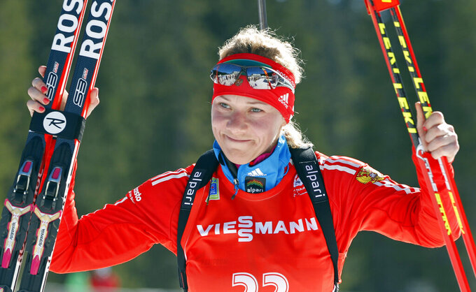 FILE - In this Sunday, March 9, 2014 file photo, Russia's Olga Zaitseva celebrates her third place in the women's 12.5km mass start at the biathlon World Cup competition in Pokljuka, Slovenia. Two-time Olympic biathlon champion Olga Zaitseva lost her appeal Thursday Sept. 24, 2020, against disqualification from the 2014 Sochi Olympics for her part in Russia's state-backed doping program. (AP Photo/Darko Bandic, File)
