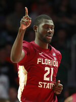 Florida State center Christ Koumadje celebrates after scoring during the first half of an NCAA college basketball game against Miami, Sunday, Jan. 27, 2019, in Coral Gables, Fla. (AP Photo/Wilfredo Lee)