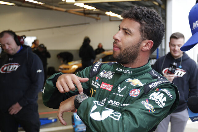 FILE - In this Feb. 14, 2020 file photo, Bubba Wallace motions to his crew about time left before getting in his car during practice for the NASCAR Daytona 500 auto race at Daytona International Speedway in Daytona Beach, Fla. (AP Photo/John Raoux, File)
