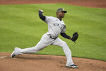 New York Yankees starting pitcher Domingo German throws a pitch during the first inning of the team's baseball game against the Baltimore Orioles on Saturday, May 15, 2021, in Baltimore. (AP Photo/Terrance Williams)