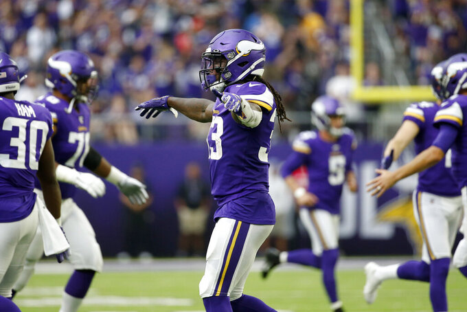 Minnesota Vikings running back Dalvin Cook (33) celebrates after scoring on a 1-yard touchdown run during the first half of an NFL football game against the Oakland Raiders, Sunday, Sept. 22, 2019, in Minneapolis. (AP Photo/Bruce Kluckhohn)