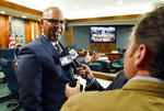 Pico Rivera, Calif. City Councilman and El Rancho High School teacher Gregory Salcido, left, is interviewed following a city council meeting at Pico Rivera City Hall on Tuesday, Feb. 13, 2018, in Pico Rivera, Calif. The city council passed a resolution asking for the resignation of Salcido, who was recorded making anti-military remarks to his students in January. (AP Photo/Chris Pizzello)