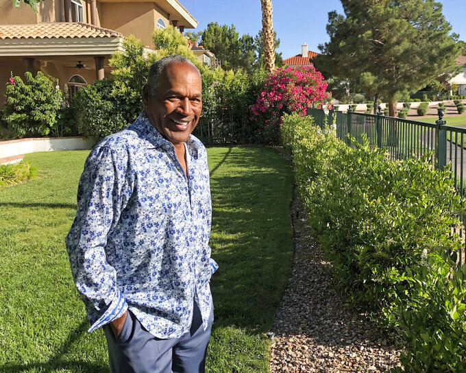 This photo provided by Didier J. Fabien shows O.J. Simpson in the garden of his Las Vegas area home on Monday, June 3, 2019. After 25 years living under the shadow of one of the nation's most notorious murder cases, Simpson says his life now is fine. (Didier J. Fabien via AP)