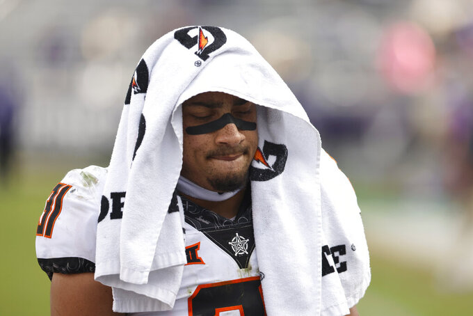 Oklahoma State safety Kolby Harvell-Peel (31) walks off the field following a loss to TCU in an NCAA college football game Saturday, Dec. 5, 2020, in Fort Worth, Texas. (AP Photo/Ron Jenkins)