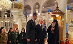 This image released by the Syrian Presidency, shows Russian President Vladimir Putin, third right, and Syrian President Bashar Assad, center, visiting an orthodox cathedral for Christmas, in Damascus, Syria, Tuesday, Jan. 7, 2020. Putin's visit is the second to the war-torn country where his troops have been fighting alongside Syrian government forces since 2015. (Syrian Presidency via AP)