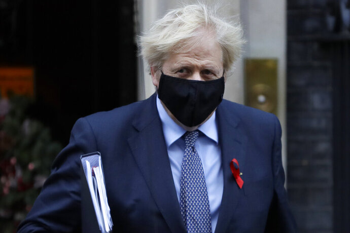 Britain's Prime Minister Boris Johnson leaves Downing Street to attend Parliament in London, Tuesday, Dec. 1, 2020. Members of Parliament will vote later Tuesday on the proposed tier system as the country prepares to come out of lockdown. (AP Photo/Kirsty Wigglesworth)