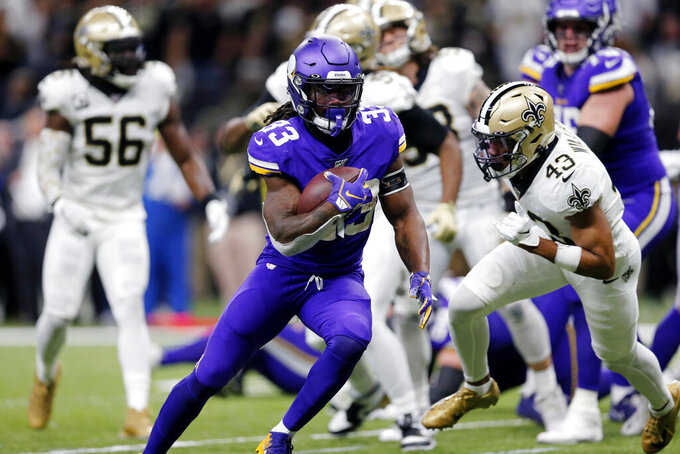 Minnesota Vikings running back Dalvin Cook (33) carries for a touchdown in front of New Orleans Saints free safety Marcus Williams (43) in the first half of an NFL wild-card playoff football game, Sunday, Jan. 5, 2020, in New Orleans. (AP Photo/Brett Duke)