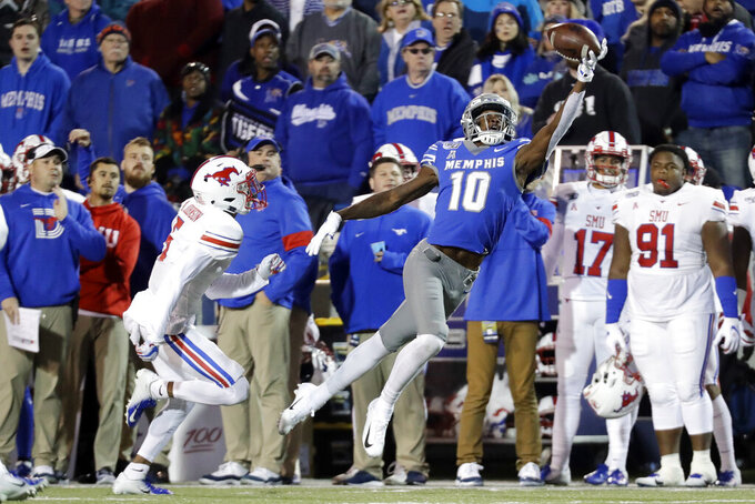 Memphis wide receiver Damonte Coxie (10) makes a catch as he is defended by SMU cornerback Ar'mani Johnson in the first half of an NCAA college football game Saturday, Nov. 2, 2019, in Memphis, Tenn. (AP Photo/Mark Humphrey)