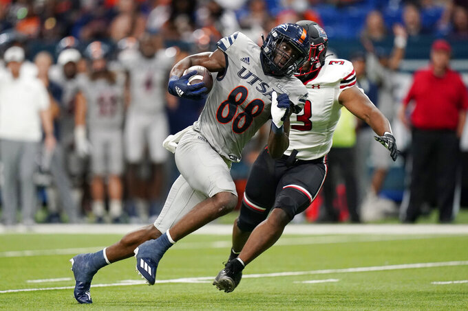 UTSA wide receiver De'Corian Clark (88) runs for a touchdown past Lamar linebacker Caimyn Layne (3) after making a catch during the second half of an NCAA college football game Saturday, Sept. 11, 2021, in San Antonio. (AP Photo/Eric Gay)