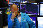 Specialist Meric Greenbaum works on the floor of the New York Stock Exchange, Friday, Aug. 23, 2019. Stocks tumbled on Wall Street after President Donald Trump said he
